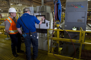 Employees at Roseburg Forest Product's Riddle plywood plant program a machine at the mill. Engineers and millwrights often use technology in sawmills that requires workers who are highly skilled and trained, but not necessarily college graduates.