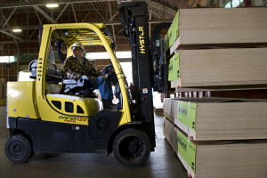 A forklift operator prepares to move material to be shipped as he works at the Dillard-based composites facility at Roseburg Forest Products.