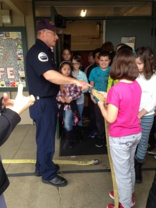 Fir Grove Elementary students receive visitors from Roseburg Fire Department and Douglas County Fire District No. 2.