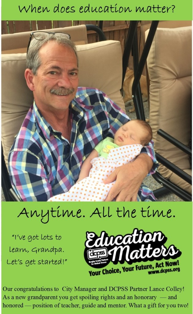 Roseburg City Manager and DCPSS partner Lance Colley holds his first grandchild. Brain development in the first few years of life makes learning, engagement and experiences an important part of making education matter to kids at a young age.
