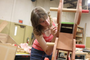 A Roseburg High student does detail work on a rocking horse that started as a drafting project and became part of a CTE woodshop class.